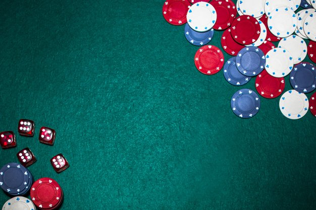 casino-chips-red-dices-green-poker-backdrop_