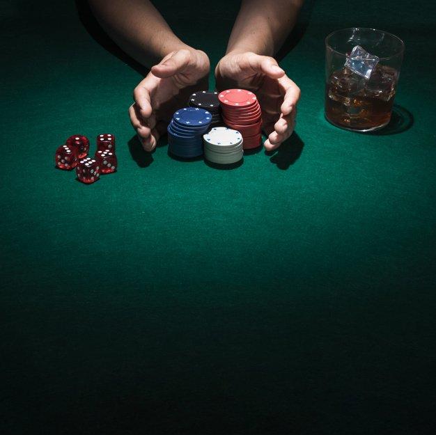 person-playing-poker-casino_